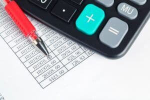 calculator and red pen