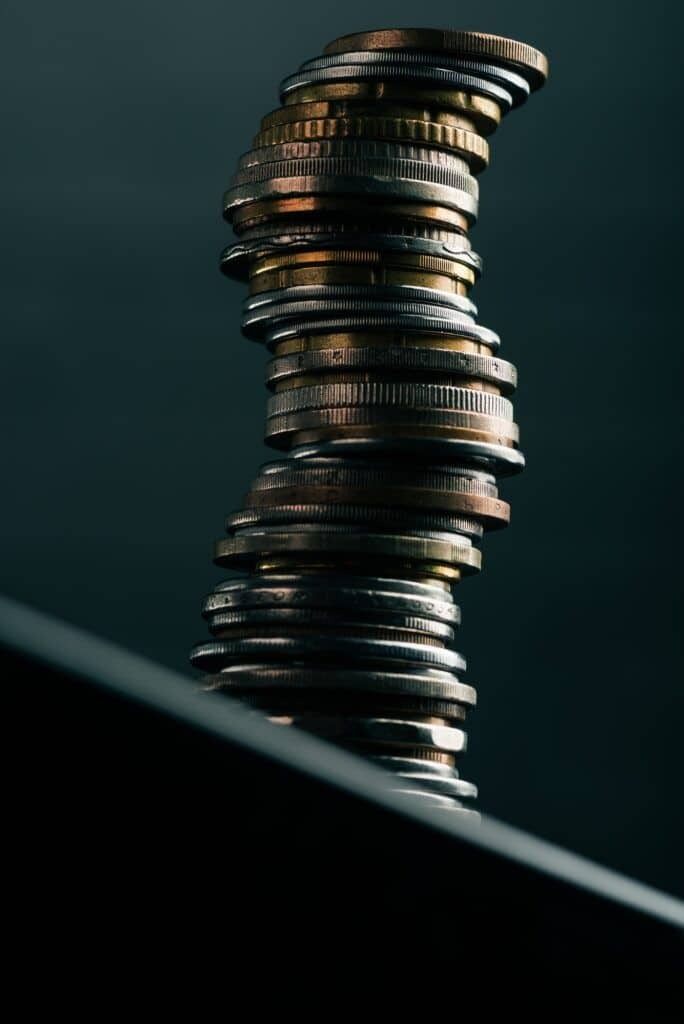 close up view of stack of different coins standing on edge of table